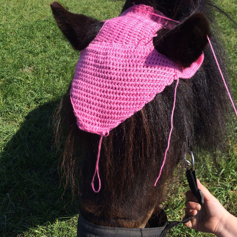rosa huva häst