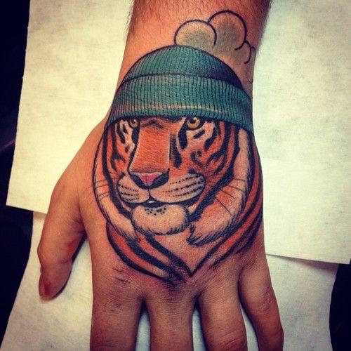 Tiger hand tattoo