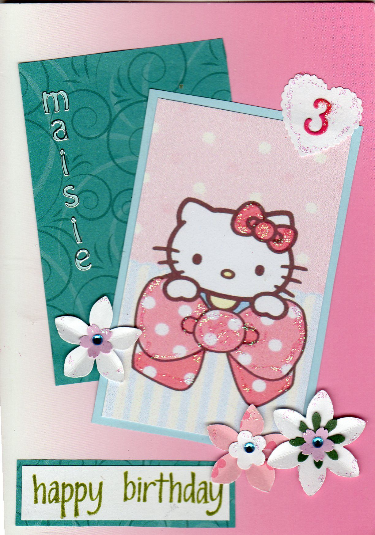 Hello Kitty with a little glitter and a few flowers