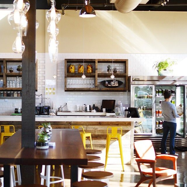 Gorgeous Restaurant Space, Community Tables, Yellow Metal Bar Stools, White Subway Tile, Exposed Pipes, Vaulted Ceilings, Lots of Natural Light // via erinireland