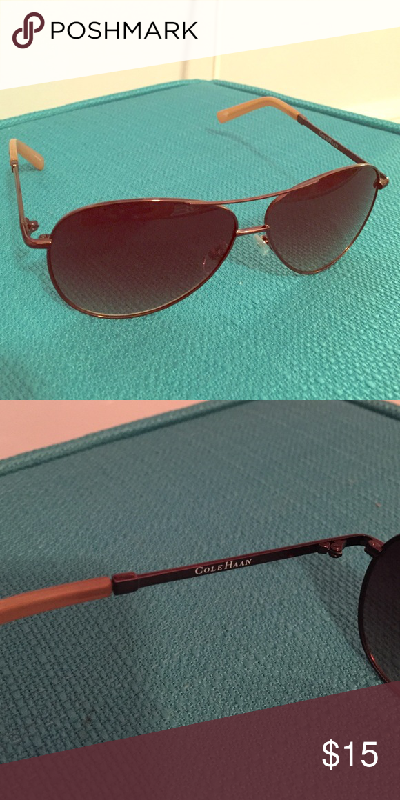 Cole Haan Aviator Sunglasses Classic aviator shape, dark brown lenses and rims. A couple very minor scratches in one lens, nothing noticeable. Otherwise great condition. Cole Haan Accessories Sunglasses
