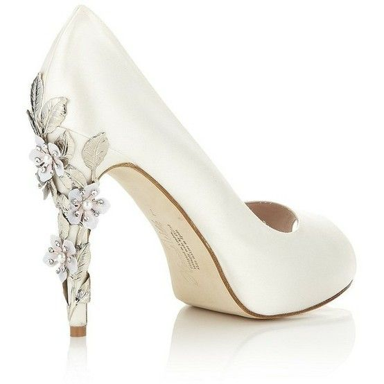 Simple white wedding shoes with a decorative floral heel  744b46039a3d