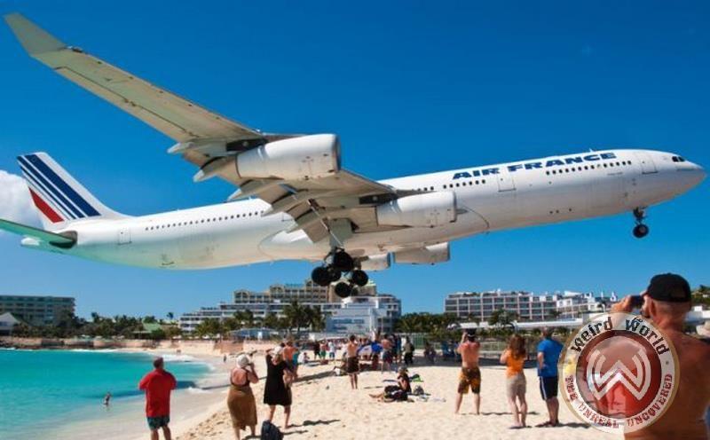 Maho Beach Popular For Low Flying Planes Landing In St Maarten