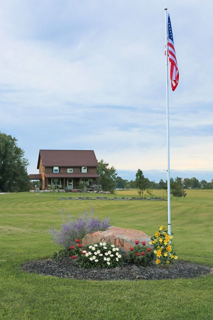 How To Add An In Ground Flagpole Landscape Around It Creative Cain Cabin Landscaping Around House Farmhouse Landscaping Front Yard
