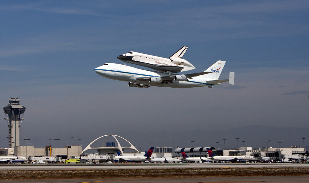 Endeavour flying over the Theme Building at LAX by Kevork Djansezian/Getty Images