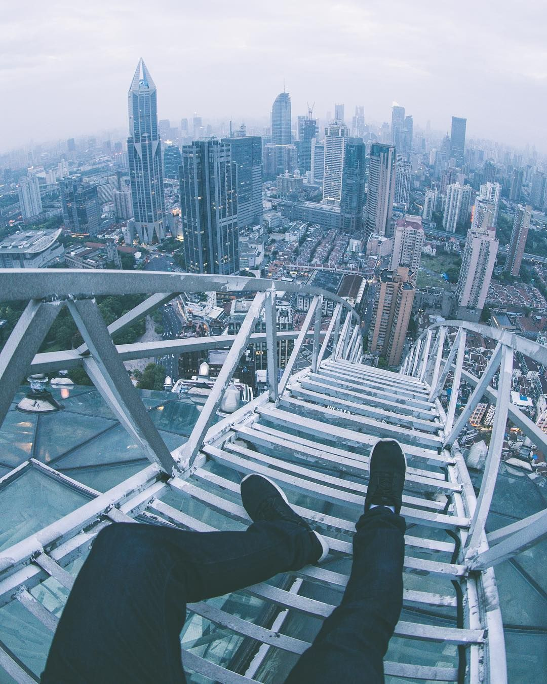 Stunning Rooftop Shots From Skyscrapers Of Shanghai By Oliver Shou - Epic photos taken from the rooftops offer a new perspective of london