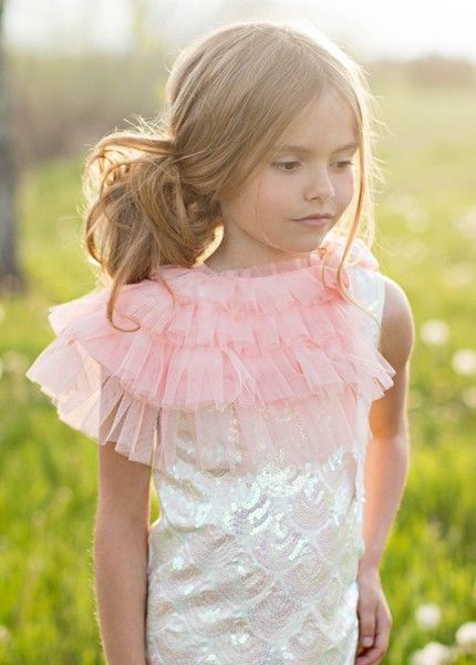 With cascading ruffles of soft tulle, this ruffled capelet adds drama to any ensemble! The ties are long, soft french grosgrain. It is lined with speckled gold satin. This piece ties around the collar and is not fitted, so it can be worn as a capelet on a child and a ruffled color on an adult. It hangs 8