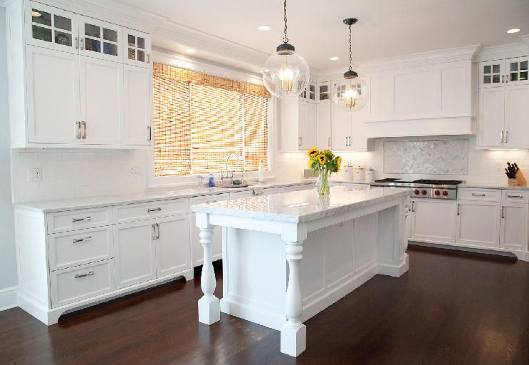 White Kitchen With Stacked Upper Cabinet And Shaker Style Doors Featured In New England Home Magazine