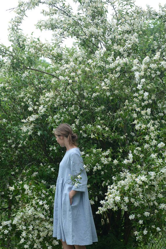 Wide and pleated linen dress with 3/4 sleeves and comfy side pockets in…