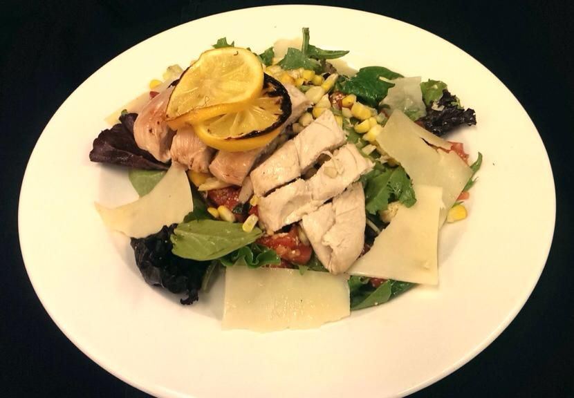 Today's lunch features some of Summer's fave ingredients: Fire Roasted Corn Salad with Tomato Confit, topped with Meyer's Lemon Roasted Chicken and shaved Parmesan.
