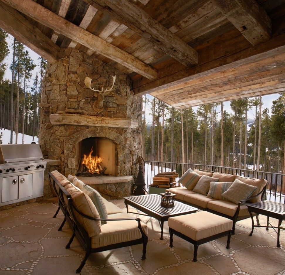 Country Forest House Design Feature Comfortable Outdoor Living Room Cushion And Stacked Stone Fireplace Plus Hardwood Roof Constructions