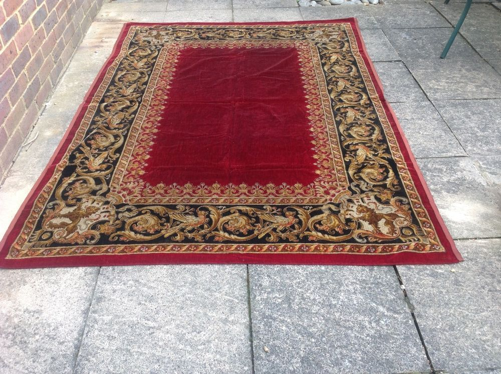 A pair of antique velvet gold thread rug / throw / wall hanging
