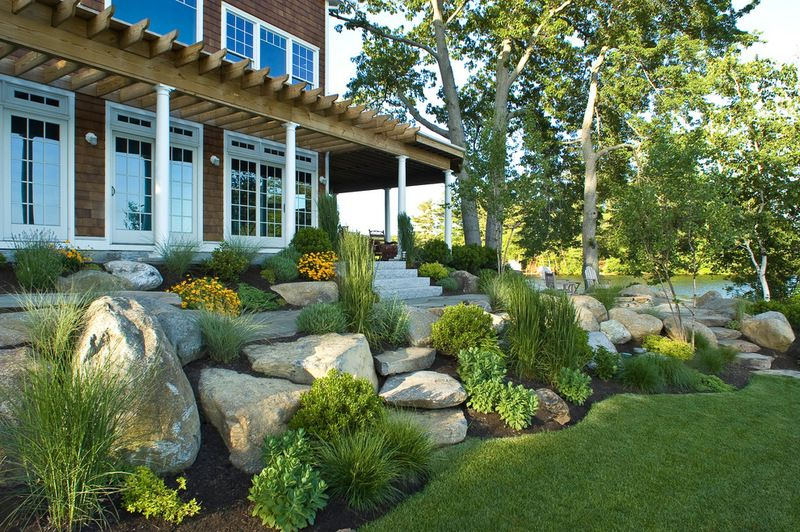 Strategically place boulders. Well-placed boulders can stabilize the on boulders in landscape, gravel in garden design, trees in garden design,