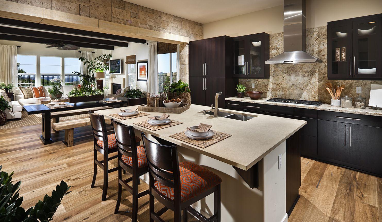 Transitional kitchen with coastal stone wall dark wood for Eldorado stone kitchen