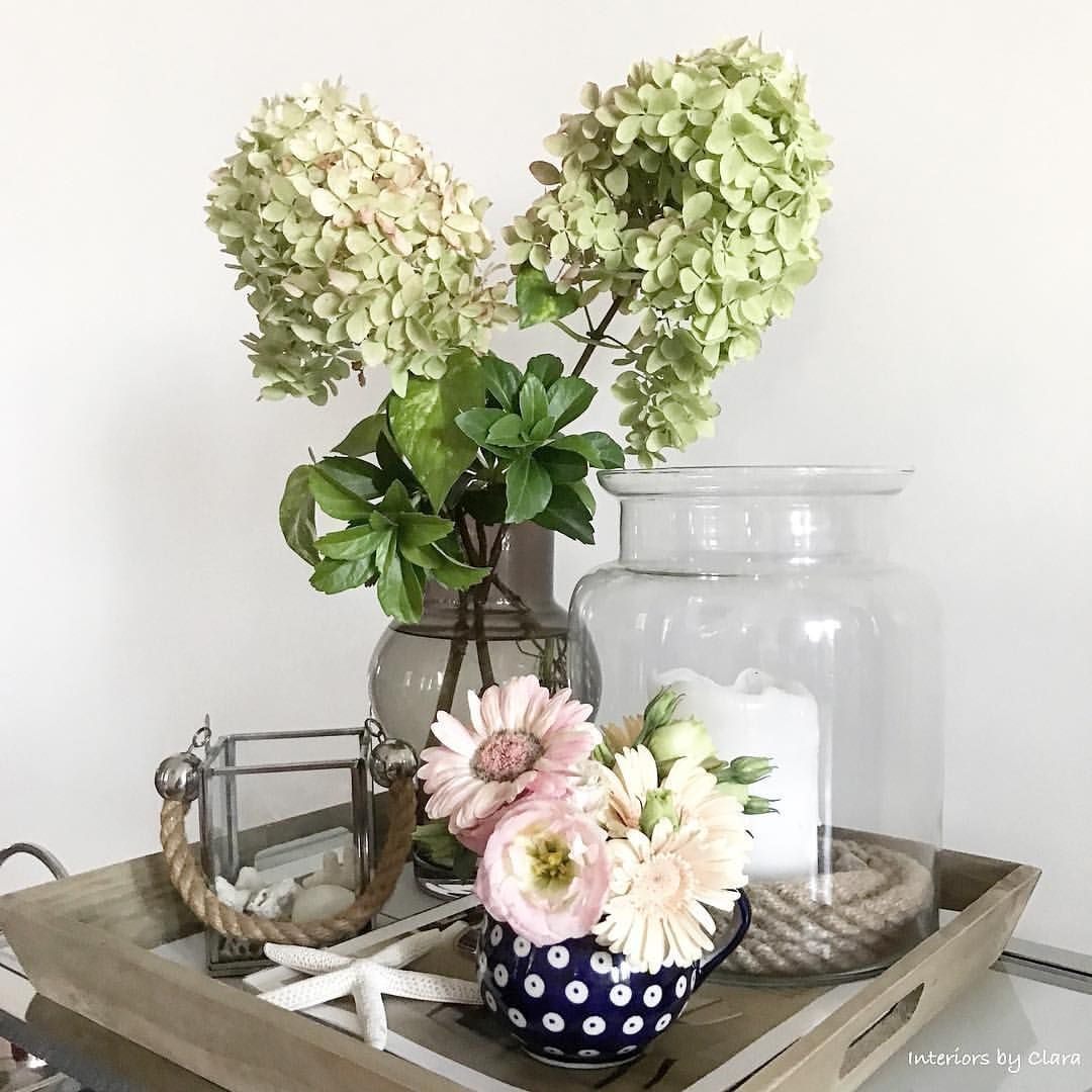 Pretty tray display with flowers and coastal accents ...