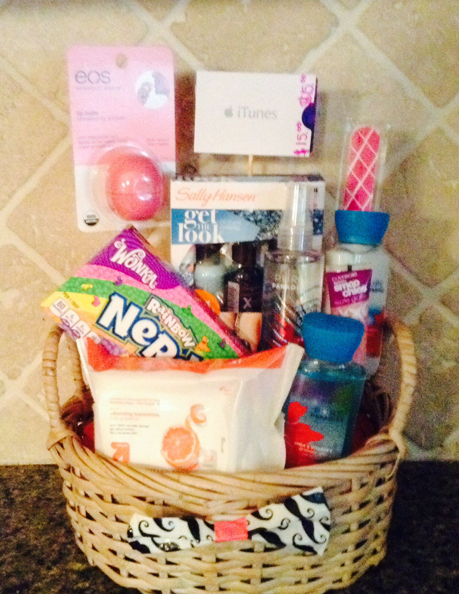 This basket includes Rainbow Nerds, $15 iTunes, Nail file, eos ...