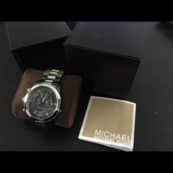 Men's authentic Michael Kors watch Dark and light silver. Comes with box and booklet. Never worn. Michael Kors Accessories Watches