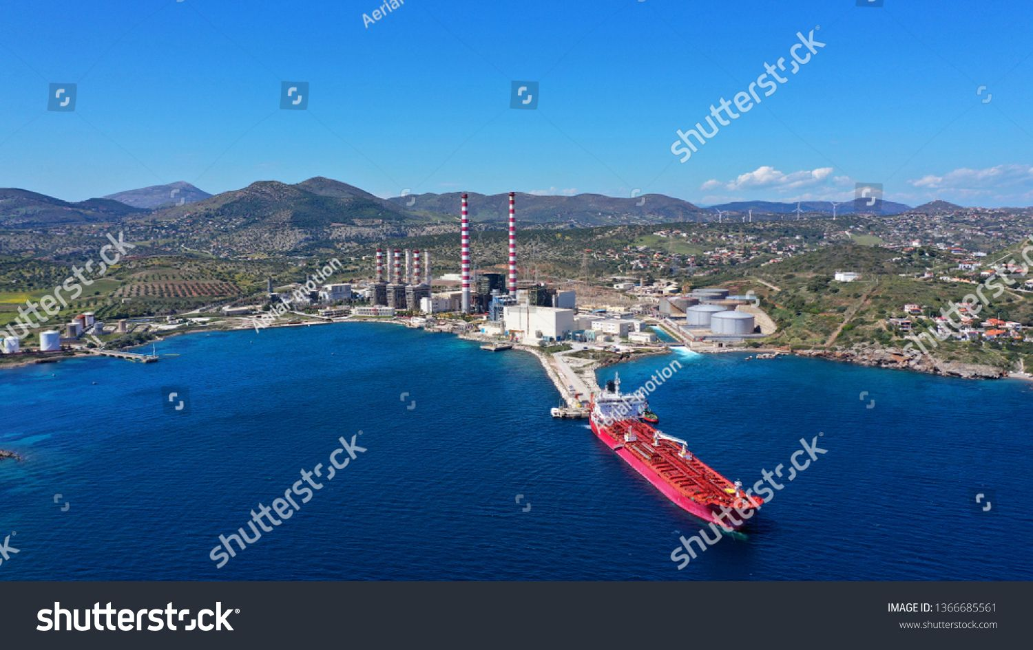 Aerial drone photo of industrial power plant by the sea in