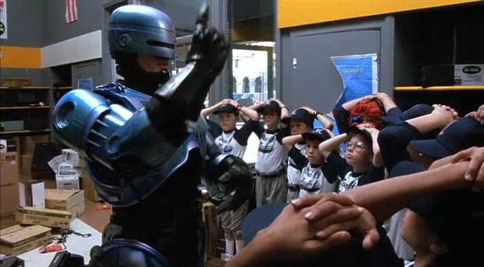 It's been years since I've seen Robocop 2. The only details I remembered from my childhood is a fight in an arcade, a terrible CG face, and ...