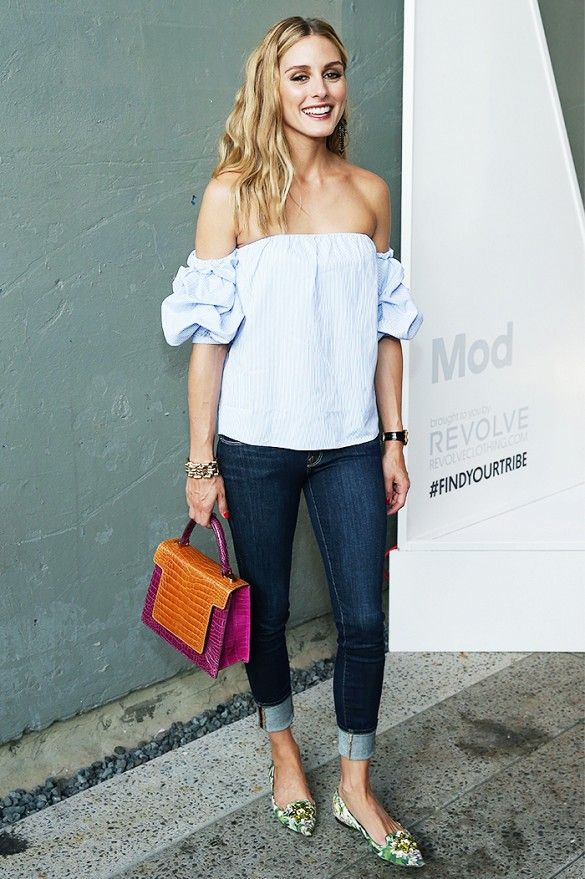 Olivia Palermo wears a blue off-the-shoulder blouse, cuffed skinny jeans,