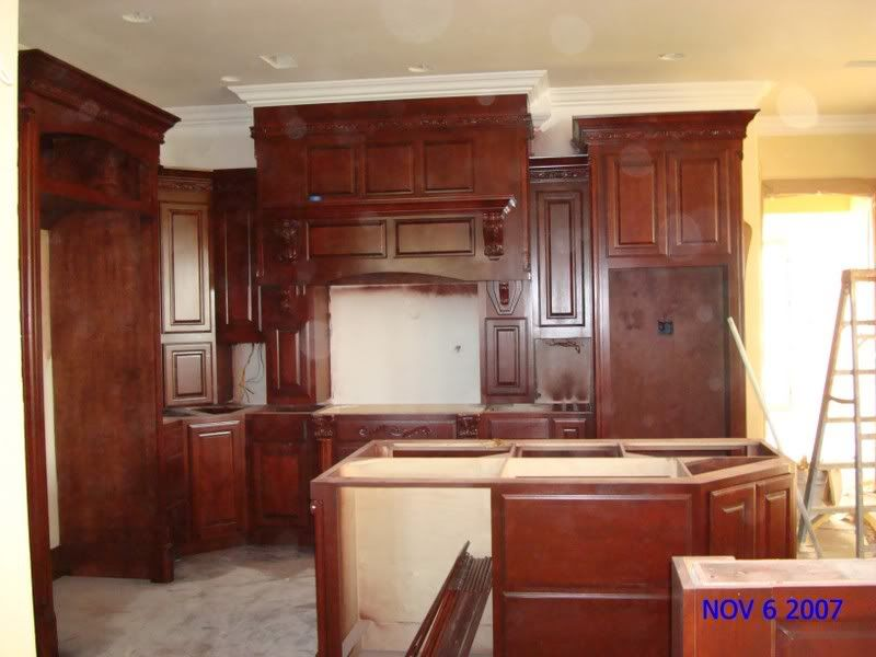 White crown over stained cabinets | Kitchen cabinets trim ...