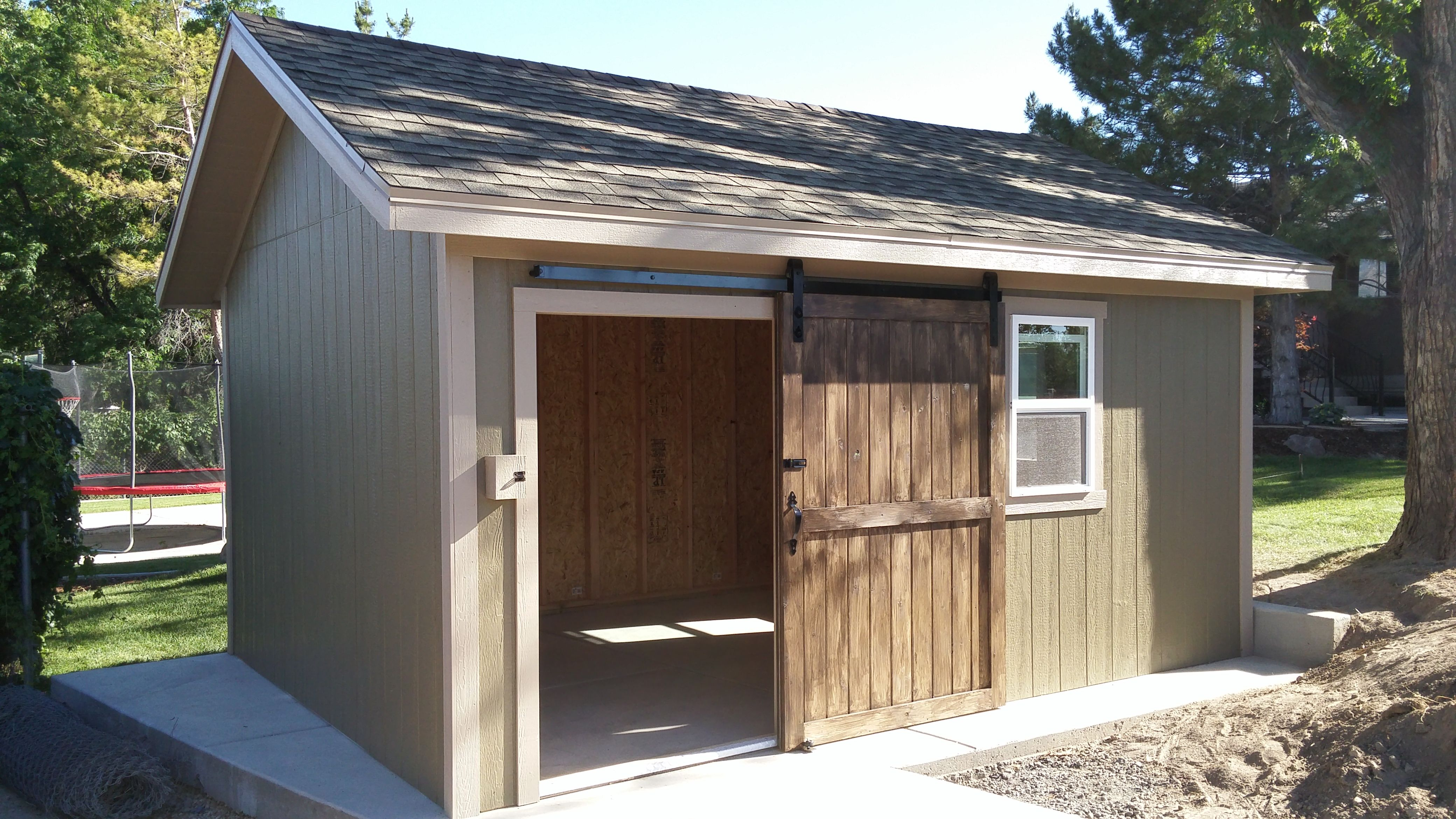 Cute green shed with sliding barn style door The Cabin
