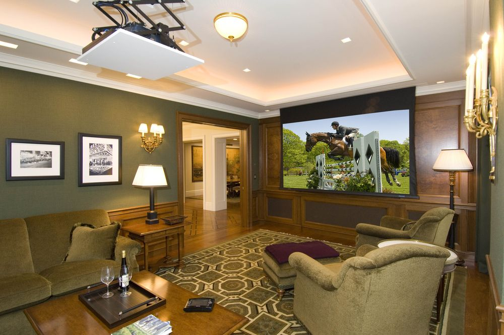 Pop Down Ceiling Projector And A Roll Up Projection Screen Transforms A Family Room Into A Home Theater Ceiling Projector Home Home Theater #projection #screen #living #room