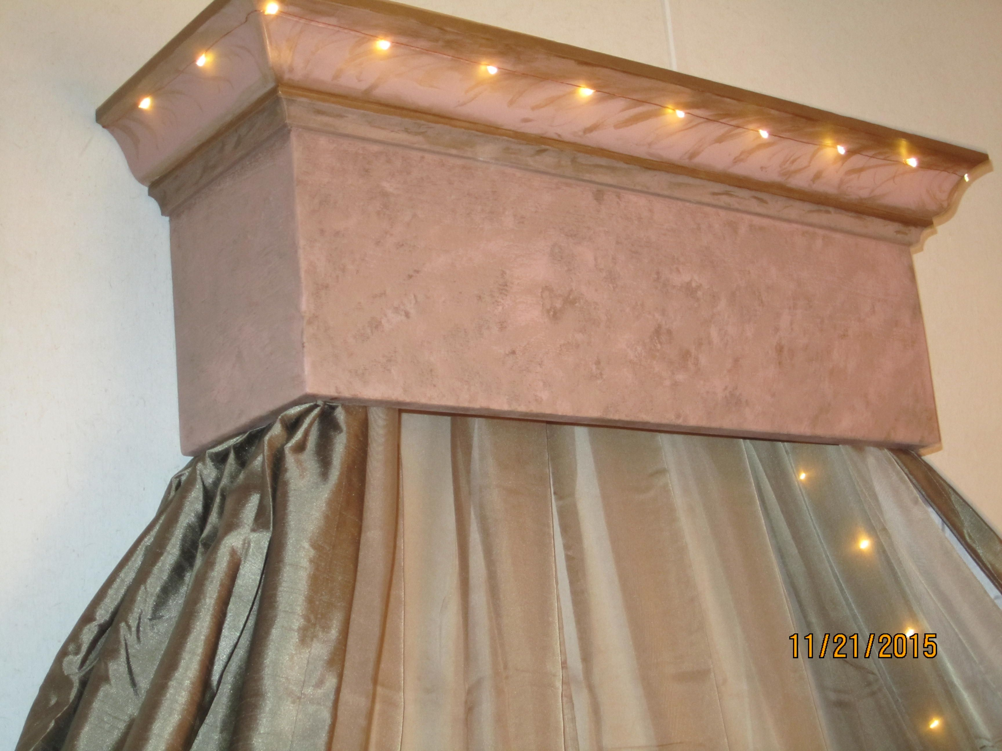 I went artistic on wood box with crown molding I designed and hubby made. Not quite marbling, but a blended wood rose and teak glazed over, with brush strokes at the top. Strung LED remote dimmer or flashing lights that extend down both sides inside the bronze drapes. The taupe sheers - 2.00 on Amazon.
