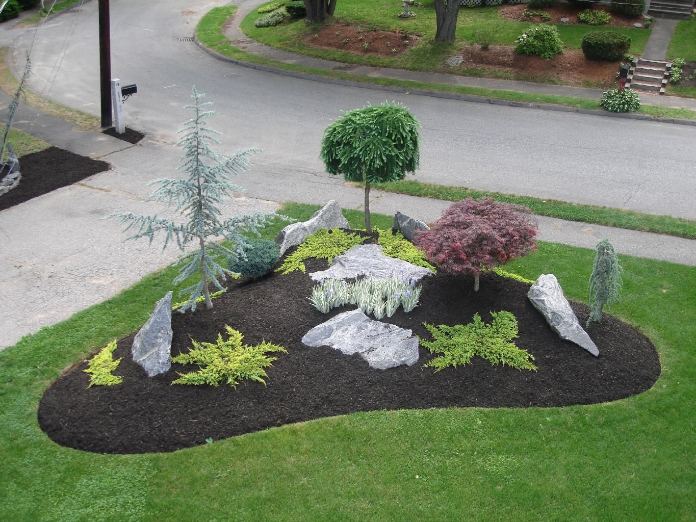 Simple landscape designs with rock beds google search for Front yard flower bed designs