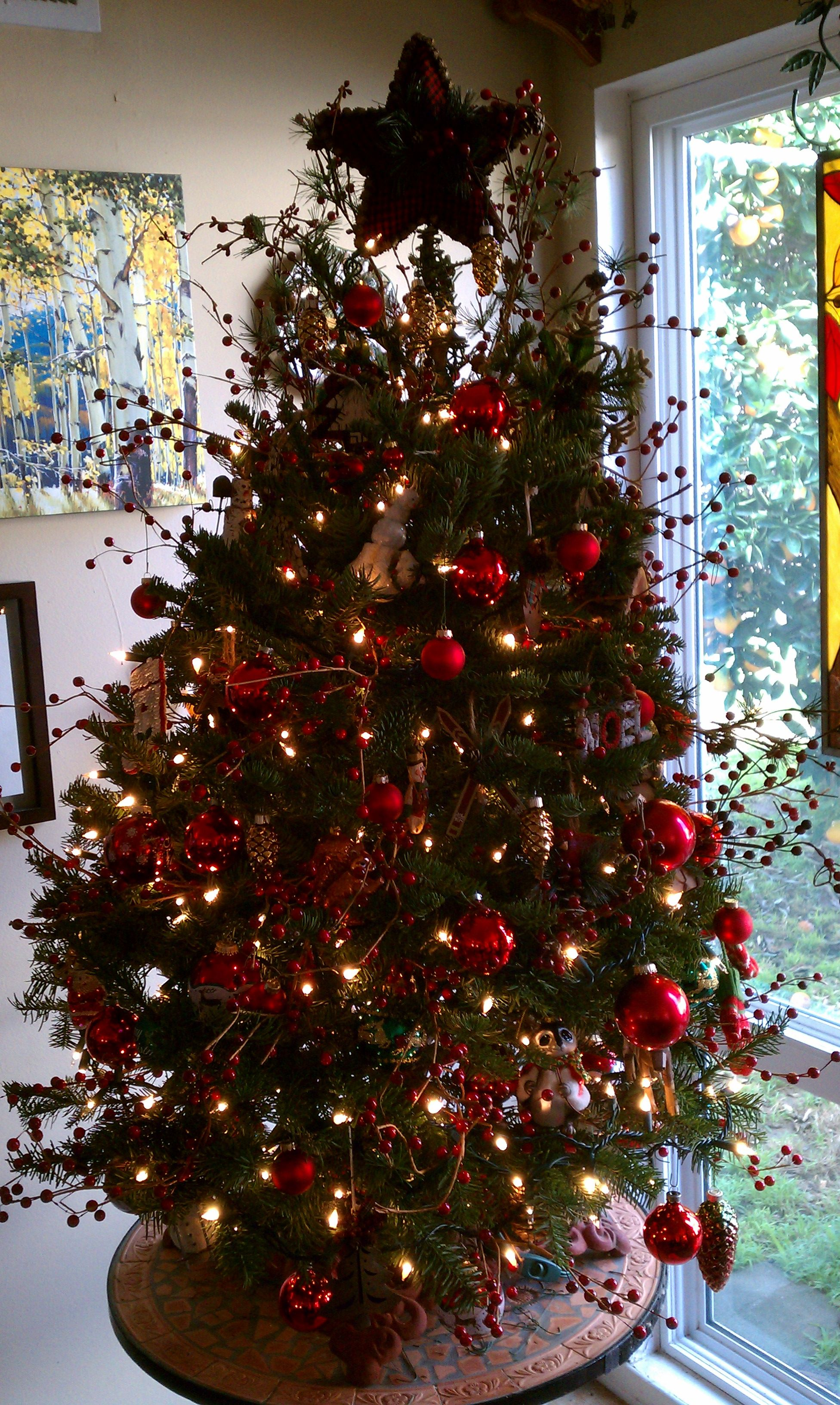 rustic Christmas tree with berry sprigs