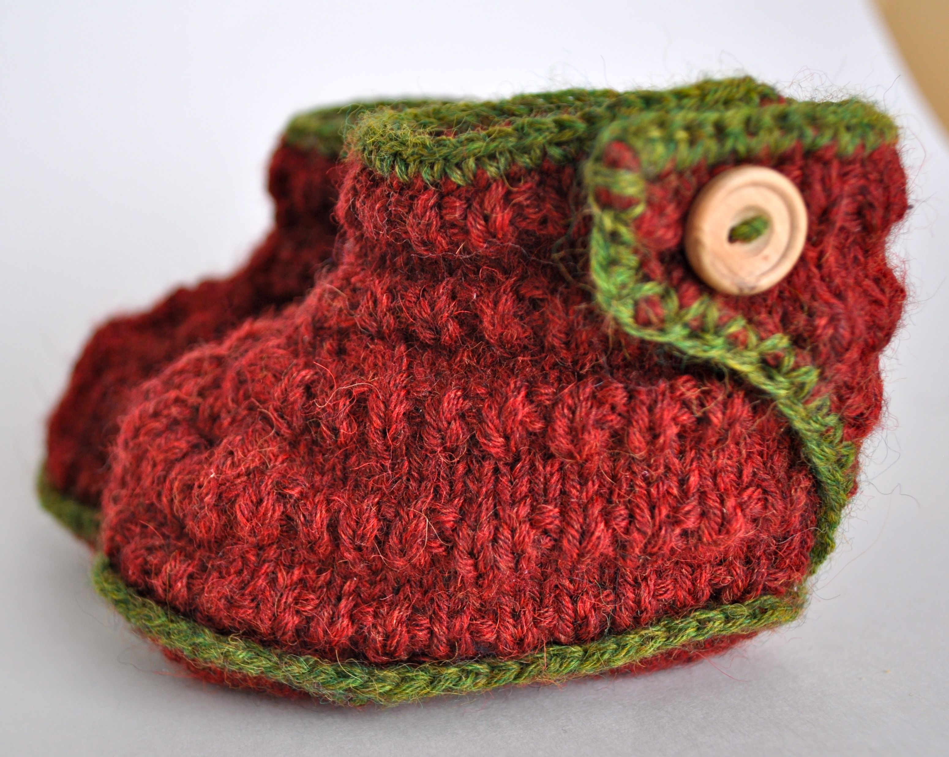 Hand knit baby booties in red strawberry style