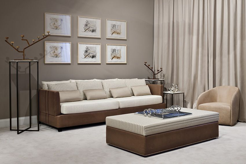 The Tancredi collection of sofa and ottoman, by Oasis, covered with leather and fabrics.