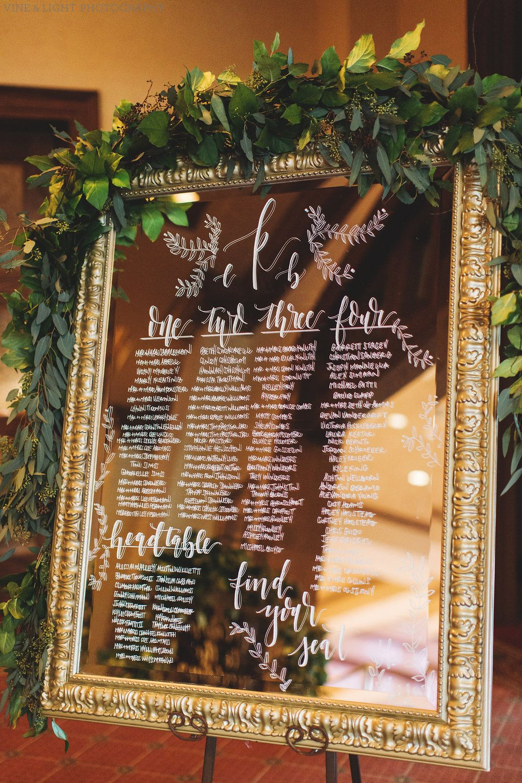 Elegant Seating Chart Features Hand Calligraphy In White