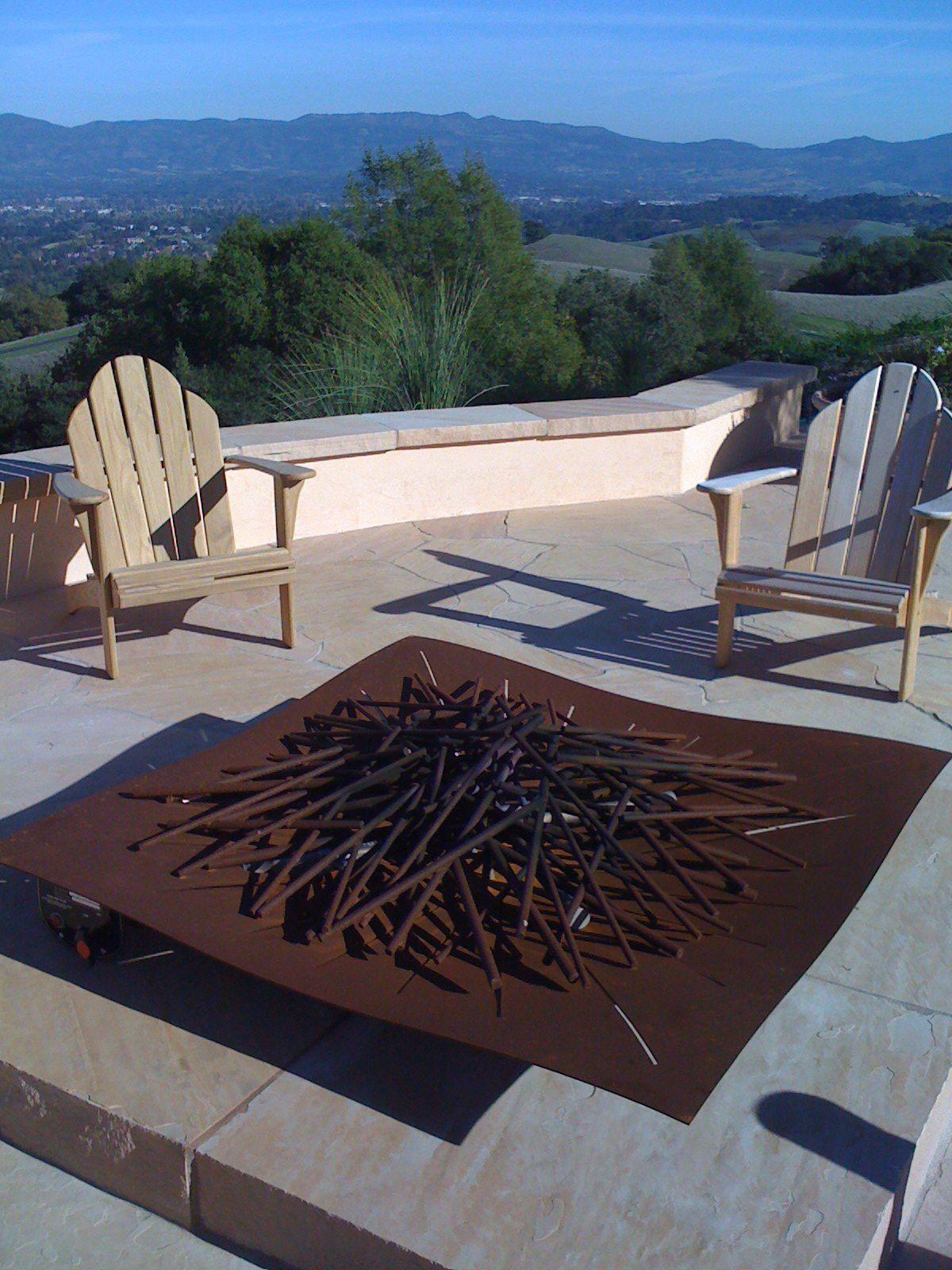 steel panel rod fire feature by elena colombo seen on http www