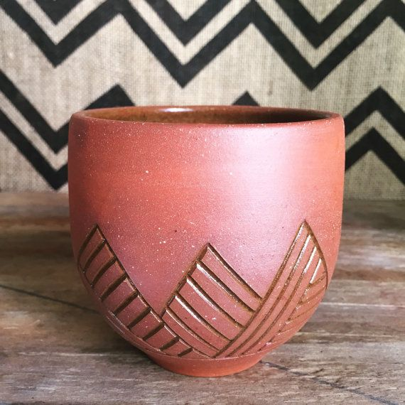 Ceramic cup raw terracotta with carved geometric