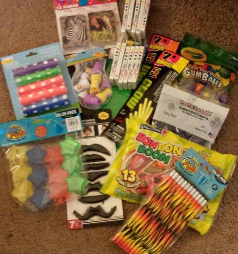 Super Mario Birthday Party treat bags:  stick-on mustaches, star power pencil sharpens, fire power pencils, flower power stampers, crayons, glow stick bracelets, crayola gumballs, and boom pops.
