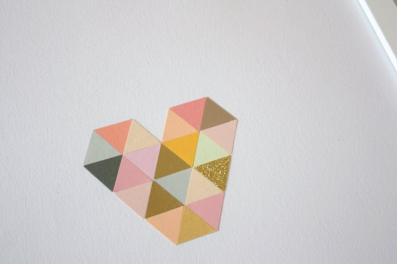 Triangles, heart shape and a touch of glitter for good measure, we love this 'Squeart' artwork.