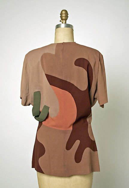 """In February 1945 Adrian was awarded the third annual American Fashion Critics Award. Thirty-two of the designer's garments were displayed at the award ceremony, including this ensemble which was part of his """"Modern Museum"""" collection"""