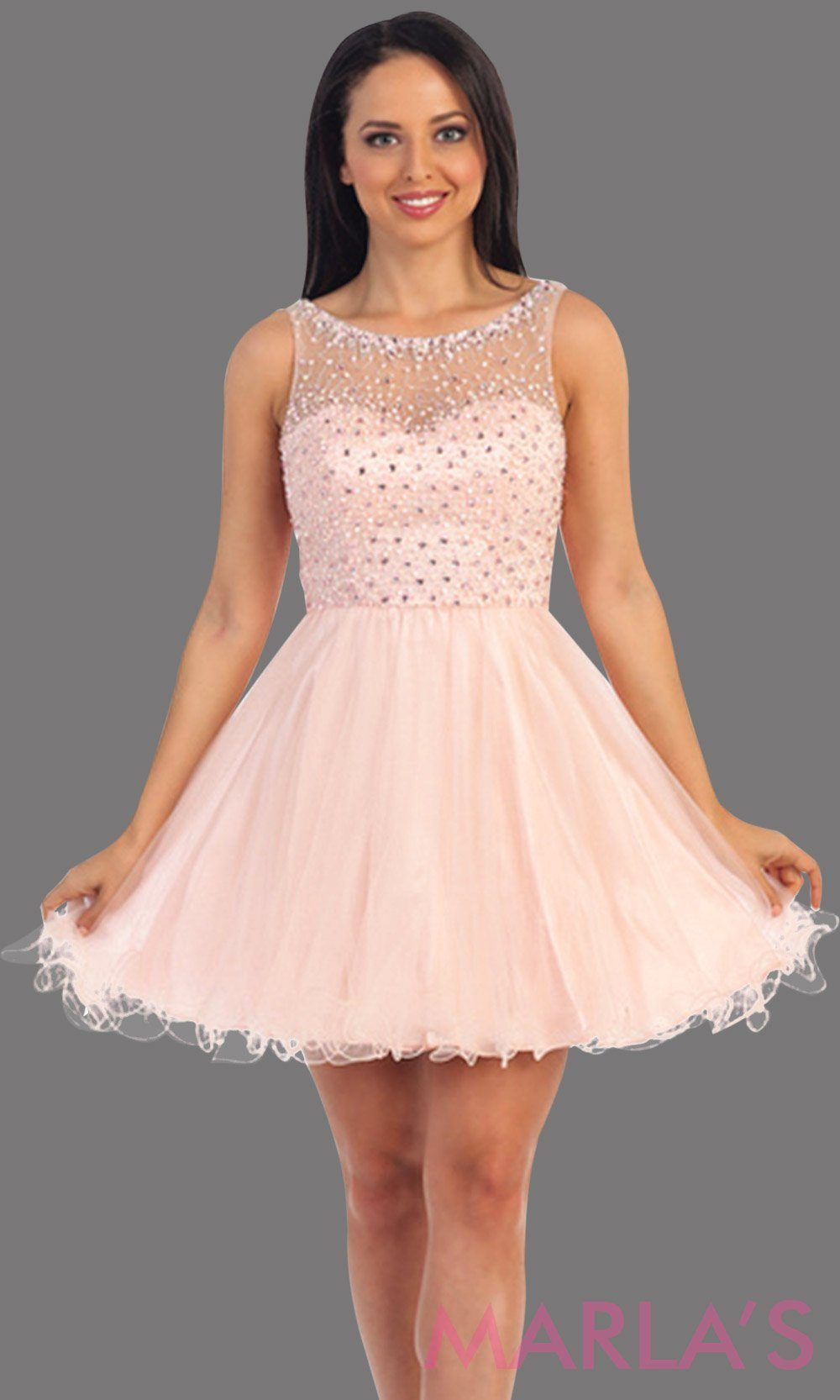 ed44b75c3d3 Short blush pink high neck graduation dress with beaded top. It has puffy  tulle skirt. Perfect for grade 8 grad