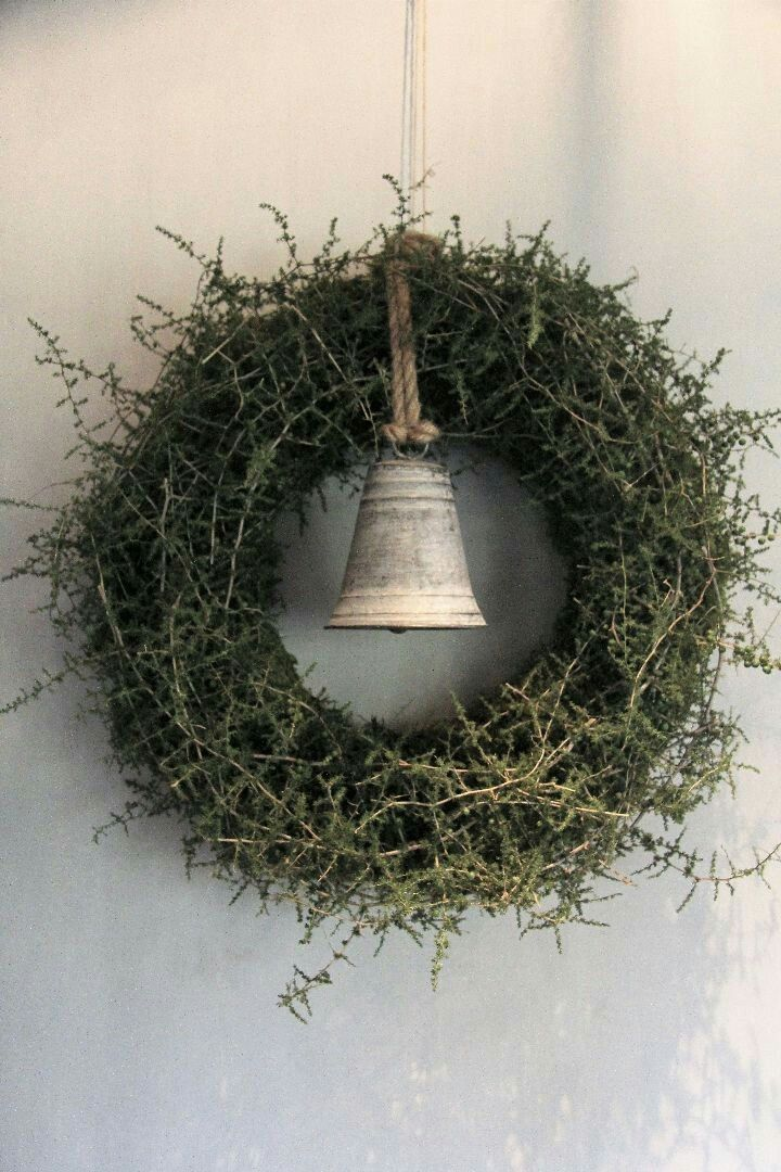 Wreath of wild asparagus with a Christmas bell decoration