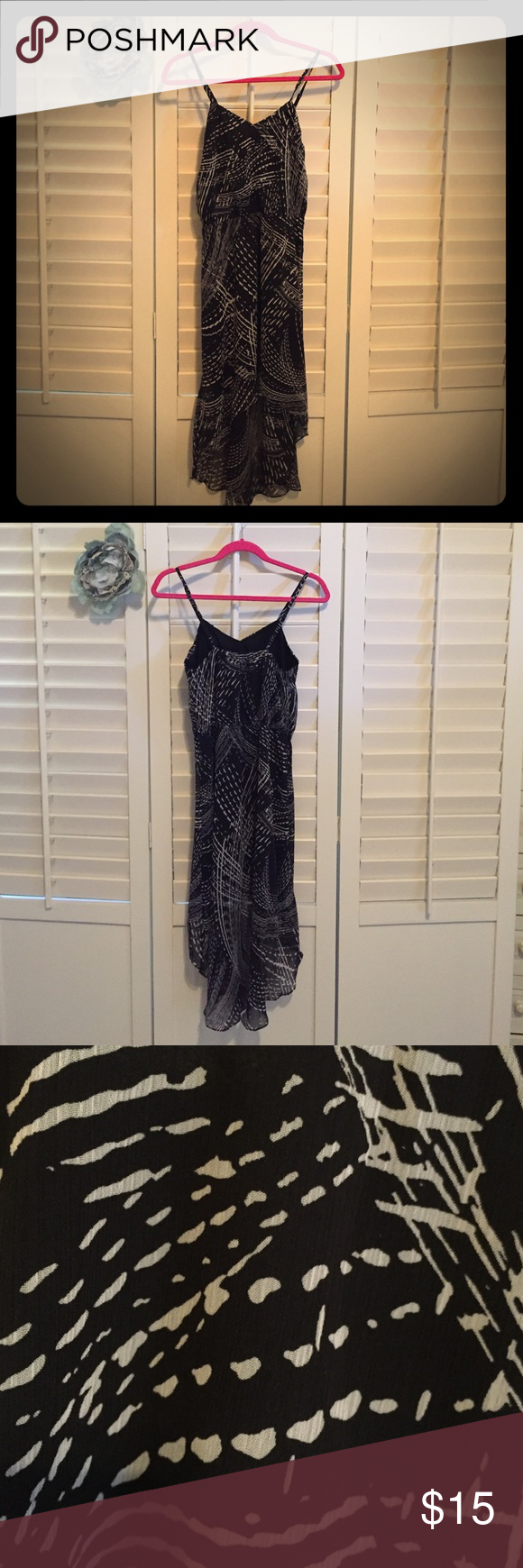 Black and White High-Low Dress Express High-Low dress with adjustable straps.  Size small and in perfect condition. Express Dresses High Low