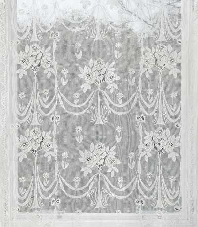 Secret Garden is a profusion of floral bouquets and ribbons to form a beautiful Nottingham Cotton Lace Curtain.  Starting at $69.95