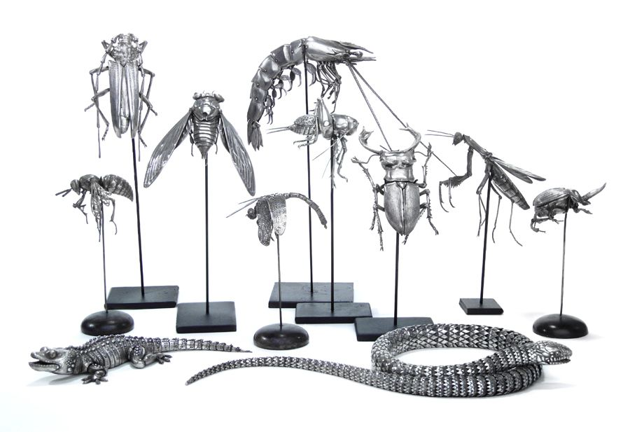 Oleg Konstantinov makes articulated metal beasts and bugs -- these look amazing. He's part of the 2012 Smithsonian Craft Show. alt link: http://www.smithsoniancraftshow.org/images5/Metal_Konstantinov.htm
