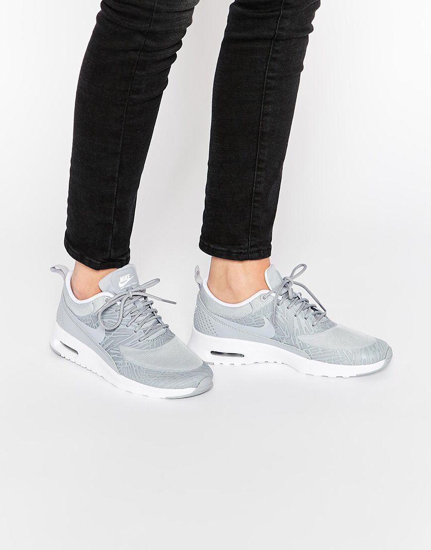 new style 47689 e028a Shop Nike Platinum Grey Print Air Max Thea Trainers at ASOS.