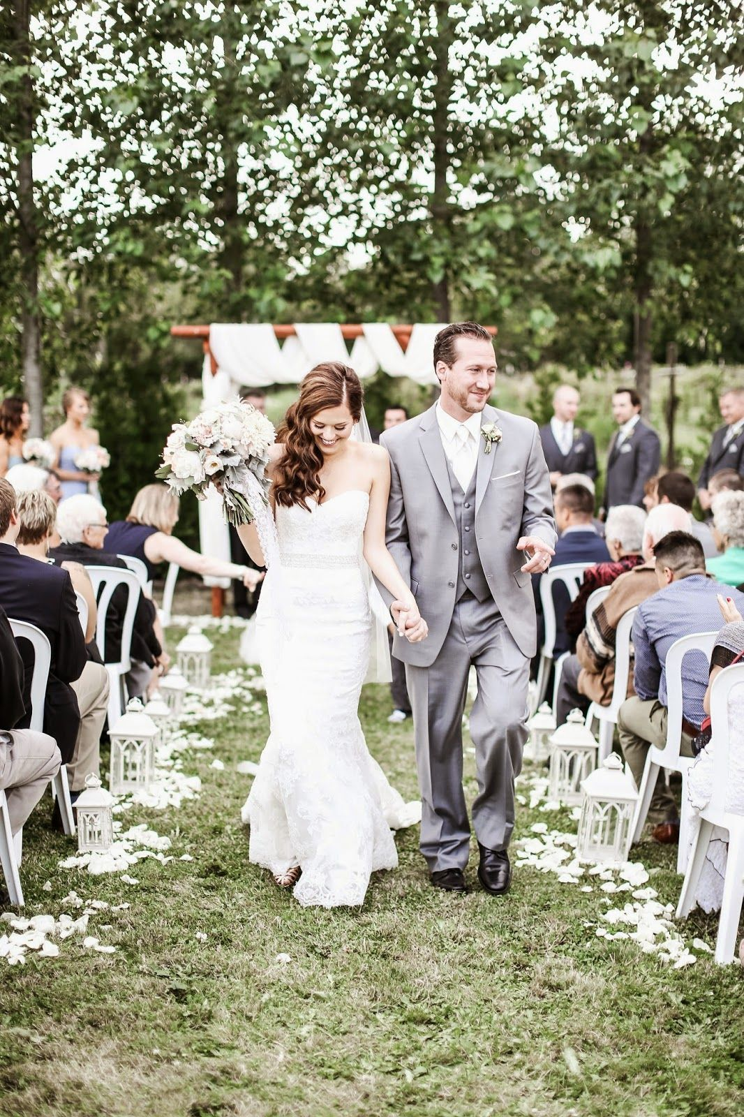 bride and groom walking after ceremony in soft pink and sage barn wedding oregon