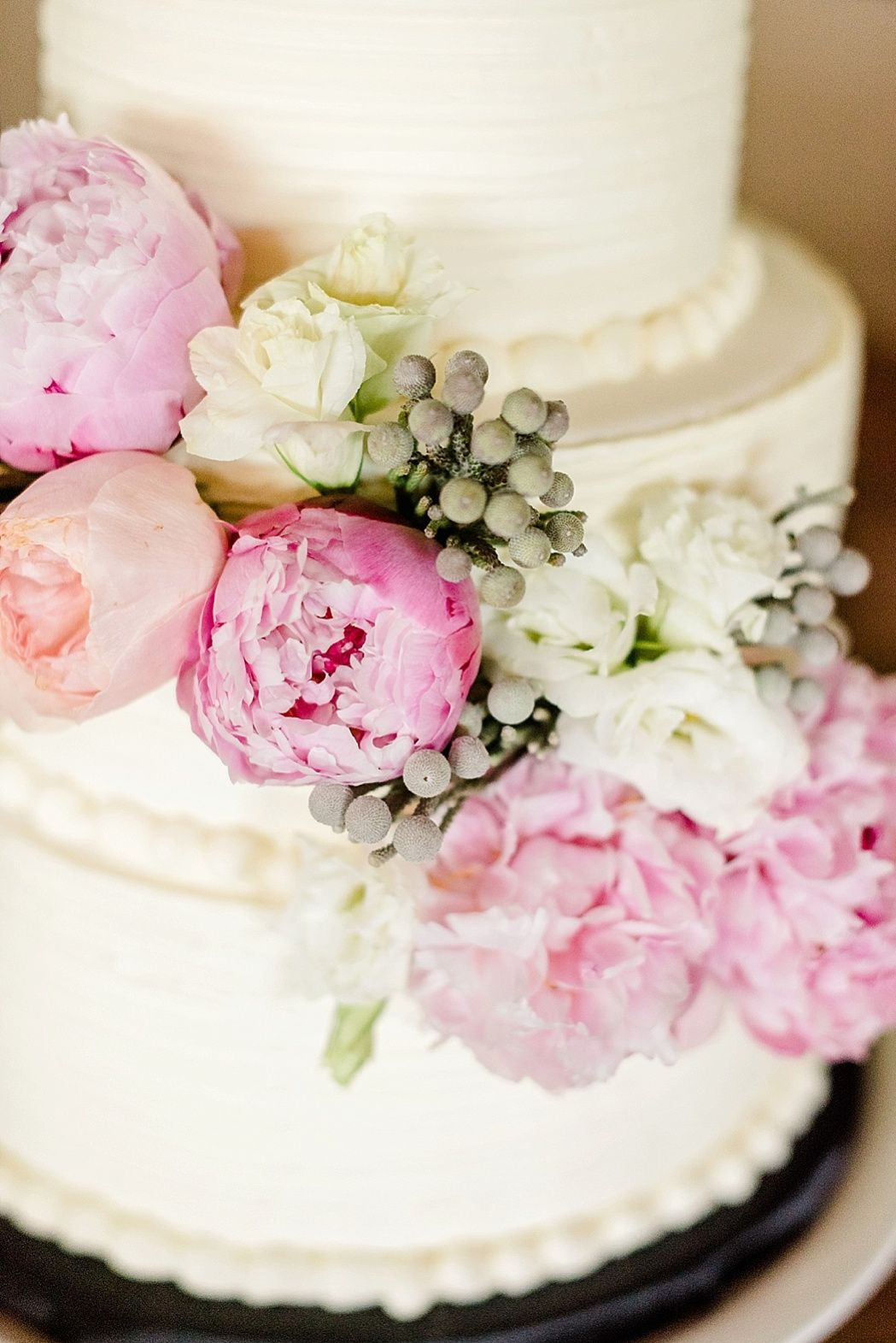 pink peonies on simple white wedding cake - Iowa Wedding Featured On ...