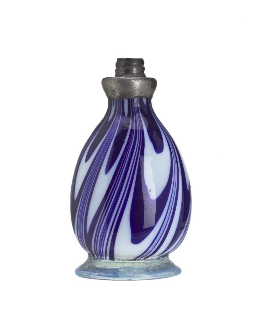 *Scent bottle of opaque white and dark blue glass with clear bluish glass foot…