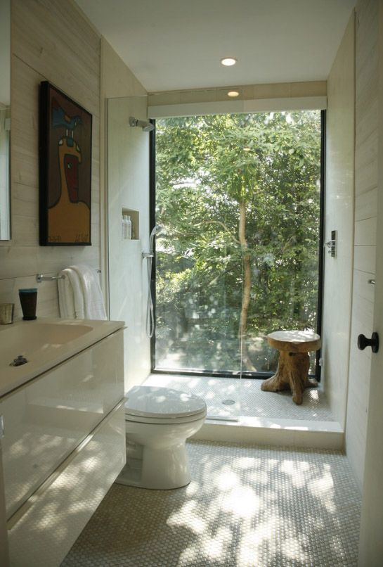 . beige bathroom floating cabinets low seat toilet floor to ceiling