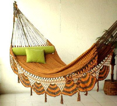 Burnt orange crochet hammock. Cute lime green cushions. Boho styling.