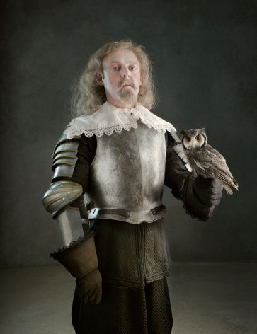 Man in armour holding an owl